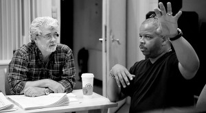 "Director George Lucas and Terence Blanchard working on the film ""Red Tails."""