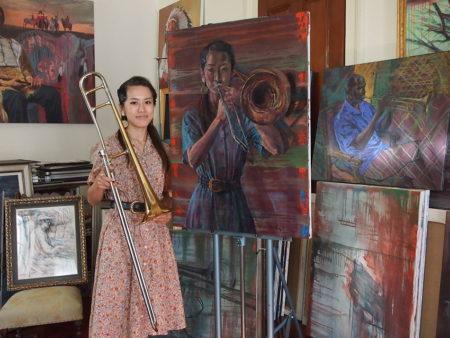 Haruka Kikuchi, with her painting by Emilie Rhys